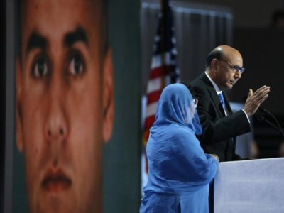 Khizr Khan speaks with an image of his son Humayun.    REUTERS/Lucy Nicholson