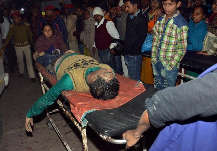 ATTENTION - VISUAL COVERAGE OF SCENES OF INJURY OR DEATH The body of a man, who died after a boat capsized, is wheeled to a hospital in Patna, India, January 14, 2017. REUTERS/Stringer