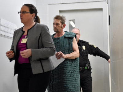 Adam Purinton, 51, accused of killing Srinivas Kuchibhotla, 32, and wounding Alok Madasani, 32, as well as an American who tried to intervene, is shown in closed circuit TV in court from the Johnson County detention center as Purinton heads towards a room with his public defender, Michelle R. Durrett (L) during his initial court appearance in Olathe, Kansas, U.S., February 27, 2017.   REUTERS/Jill Toyoshiba/The Kansas City Star/Pool