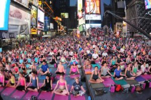 Thousands celebrate the International Day of Yoga in Tines Square.