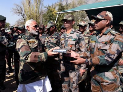 Gurez: One of the photographs shared by Prime Minister Narendra Modi on his official twitter handle where he is seen distributing sweets among soldiers on Diwali in the border town of Gurez, Jammu and Kashmir on Oct 19, 2017. (Photo: Twitter/ @narendramodi)