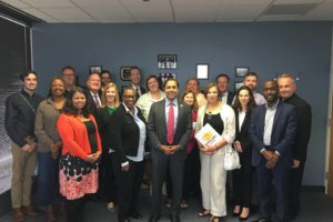 Rep Raja Krishnamoorthi, D-Illinois, center, with participants in a discussion on issues facing LGBTQ community Oct. 7