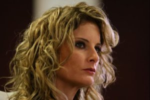 FILE PHOTO: Summer Zervos listens as her attorney Gloria Allred speaks during a news conference announcing the filing of a lawsuit against President-elect Donald Trump in Los Angeles, California, U.S., January 17, 2017.  REUTERS/Mike Blake