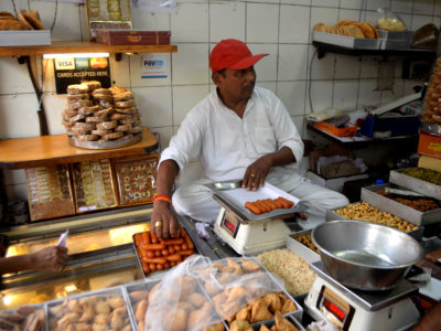 Kanwarji Bhagirathmal usually has a rush of customers during Diwali, but this year, people are spending less.  MUST CREDIT: Washington Post photo by Vidhi Doshi