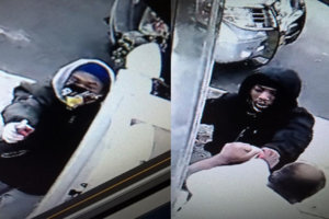 Pictures from a surveillance camera released by New York police shows a man wielding a firearm trying to force his way on Sunday into the house of Thakur Persaud, who is seen trying to push him out in the second image. (Photo: NYPD/via IANS)