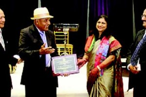 Sher Mohammed Rajput, co-founder and trustee of Indo American Center, Chicago, and trustee of East West University, Chicago, second from left, is seen receiving the Community Service Award from India's Consul General in Chicago Neeta Bhushan, Also in photo are Dr Nakedar, convenor of the American Federation of Muslims of Indian Origin, AFMI, at the recednt Chicago AFMI Convention, and AFMI's incoming President Dr Kutb Uddin Ahmed.