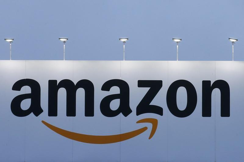 The logo of Amazon is seen at the company logistics center in Lauwin-Planque northern France