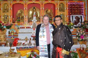 NYC Council Member Daniel Dromm and United Sherpa Association President Urgen Sherpa pose in front of a shrine at the United Sherpa Association in Elmhurst.