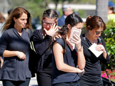 Mourners leave the funeral for Alyssa Aldaheff, 14, one of the victims of the school shooting, in North Fort Lauderdale, Florida, February 16, 2018. REUTERS/Joe Skipper
