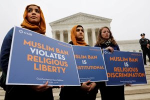 Protesters gather outside the U.S. Supreme Court, while the court justices consider case regarding presidential powers as it weighs the legality of President Donald Trump's latest travel ban targeting people from Muslim-majority countries, in Washington, DC, U.S., April 25, 2018. REUTERS/Yuri Gripas/Files
