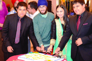 Graduates at the cake cutting ceremony.