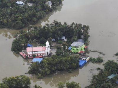 Kerala: An aerial view of the flood-hit areas of Kerala on Aug 18, 2018. Overflowing rivers and a series of landslides have caused the death of 180 people as of Saturday morning, with over three lakh people forced to move to some 2,000 relief camps. The disaster has triggered an unprecedented rescue and relief operation led by the Army, the Air Force and the Navy along with teams of National Disaster Response Force involving about 1,300 personnel and 435 boats. Prime Minister Narendra Modi on Saturday announced Rs 500 crore financial assistance for flood-ravaged Kerala. (Photo: IANS/PIB)