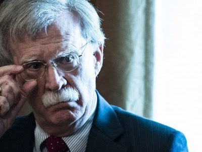 National security adviser John Bolton listens as President Donald Trump speaks during a Cabinet meeting at the White House on Aug 16. (Washington Post photo by Jabin Botsford