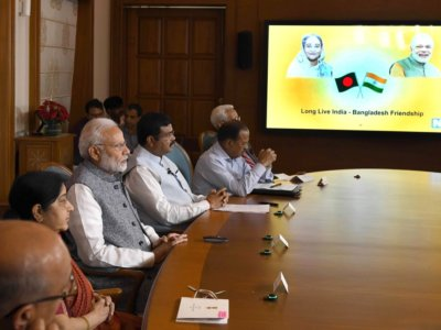 New Delhi: Prime Minister Narendra Modi and his Bangladeshi counterpart Sheikh Hasina jointly unveil e-plaques for the ground-breaking ceremony of two projects - India-Bangladesh Friendship Pipeline and Dhaka-Tongi-Joydebpur Railway Project via video conferencing, in New Delhi on Sept 18, 2018. Also seen External Affairs Minister Sushma Swaraj and Union Petroleum and Natural Gas and Skill Development and Entrepreneurship Minister Dharmendra Pradhan. (Photo: IANS/PIB)
