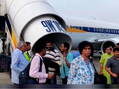 Passengers stand on the tarmac after an emergency landing, due to lost cabin pressure, on a Jet Airways flight, in Mumbai, India September 20, 2018 in this still image obtained from social media video. Melissa Tixiera via REUTERS