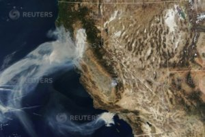A NASA Terra satellite image shows smoke continuing to spread west from the Camp Fire and two more fires, the Hill and Woolsey Fires in southern California, U.S., on November 9, 2018. Courtesy NASA/Handout via REUTERS