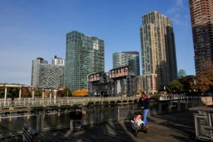 FILE PHOTO: A woman pushes a stroller at Gantry Plaza State Park, in Long Island City, Queens, New York City, U.S., November 7, 2018.  REUTERS/Eduardo Munoz/File Photo
