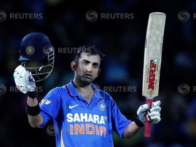 India's Gautam Gambhir celebrates after scoring a century during the third One-Day International cricket match against Sri Lanka in Colombo, July 28, 2012. REUTERS/Dinuka Liyanawatte/File Photo