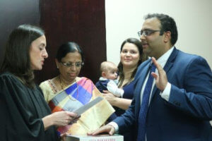 Illinois State Senator Ram Villivalam, was sworn into office Jan. 5. Seen in picture are his mother holding the Bhagavad Gita, as his wife Elizabeth, and child look on. (Photo: Ram Villivalam)
