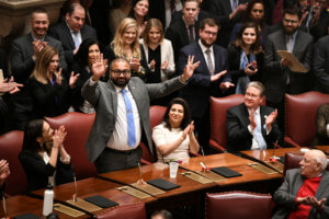 New York State Senator Kevin Thomas speaking on the Senate floor in Albany as his fellow legislators applaud. Sen. thomas is the first and only Indian-American lawmaker in the Empire State's history. (Photo courtesy office of Sen. Thomas)