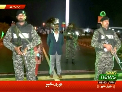 Indian pilot, Wing Commander Abhinandan, stands under armed escort near Pakistan-India border in Wagah, Pakistan in this March 1, 2019 image from a video footage. REUTERS/PTV via Reuters TV