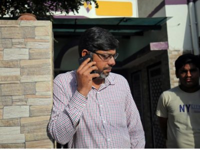 Altaf Khokhar, son of Mahebubbhai Khokhar who was killed in Friday's mosque attacks in New Zealand, speaks on his mobile phone outside his home in Surendranagar in the western state of Gujarat, India, March 17, 2019. Photo:REUTERS/Amit Dave
