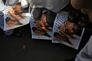 Demonstrators step on the posters of Maulana Masood Azhar, head of Pakistan-based militant group Jaish-e-Mohammad which claimed attack on a bus that killed 44 Central Reserve Police Force (CRPF) personnel in south Kashmir on Thursday, during a protest in Mumbai, India, February 15, 2019. REUTERS/Francis Mascarenhas/File Photo