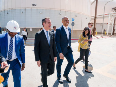 Sabrina Singh, national press secretary for the Presidential campaign of New Jersey Sen. Cory Booker, is seen her walking with the Senator. (Photo courtesy Sabrina Singh)