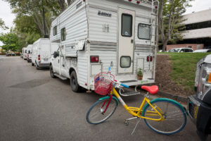 A Google bicycle stands behind a recreational vehicle parked on Landings Drive in Mountain View, Calif., on May 14, 2019. MUST CREDIT: Bloomberg photo by David Paul Morris.