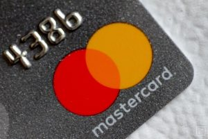 A Mastercard logo is seen on a credit card in this picture illustration August 30, 2017. REUTERS/Thomas White/Illustration/File photo