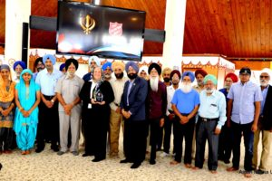 Major Nancy Power of Salvation Army Chicago with Sikh Religious Society members at Awards Ceremony at Palatine Illinois Gurdwara on July 14, 2019. Standing in front row to her left with grey turban is Sarwan Singh, who also received an award from The Salvation Army. (Photo: courtesy Asian Media USA)