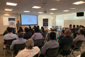 """Congressman Jesus """"Chuy"""" Garcia, D-Illinois, delivering welcome remarks at Indian American Democratic Organization, IADO's first-ever Chicago South Asian American Summit on July 13, 2019, held at the SEIU Healthcare's union hall. (Photo: courtesy IADO)"""