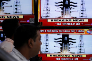 People watch a live broadcast of India's second lunar mission, Chandrayaan-2, inside an electronics showroom in Kolkata, India, July 22, 2019. REUTERS/Rupak De Chowdhuri