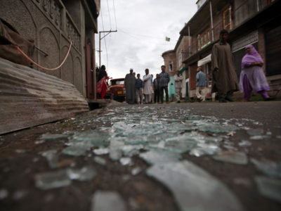 Kashmiris walk past broken window glass after clashes between protesters and the security forces on Friday evening, during restrictions following the scrapping of the special constitutional status for Kashmir by the Indian government, in Srinagar August 17, 2019. REUTERS/Danish Ismail
