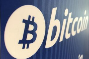 A Bitcoin logo is seen on a cryptocurrency ATM in Santa Monica, California, U.S., January 4. File Photo: Reuters /Lucy Nicholson