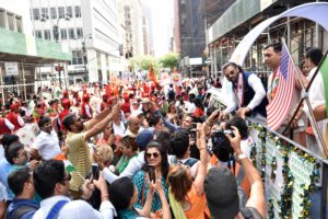 Eager fans wanting selfies and pictures as Suniel Shetty, Bollywood actor and successful businessman, leans out of the leading float at the Aug. 18, 2019, India Day Parade in Manhattan where an estimated crowd of around 100,000 people came, according to the Federation of Indian Associations-NYNJCT. (Photo: Paresh Gandhi/FIA)