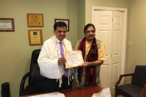"Padma Shri Dr. Sudhir Parikh, chairman of Parikh Worldwide Media and ITV Gold, left, being presented the 'Honorary Membership"" of AIMA MSME by its National President Dr. Avinash K. Dalal on Sept. 11, 2019, in Edison, N.J."