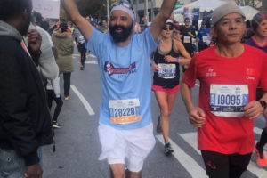 Ramanjit Singh Oberoi, who is over 60 years old, raises his arms as he successfully completes the 26.2 mile long NYC Marathon Nov. 3, 2019. (Photo courtesy HP Singh)