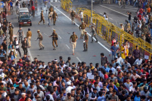 Police chase away demonstrators during a protest against Citizenship Amendment Bill (CAB), that seeks to give citizenship to religious minorities persecuted in neighbouring Muslim countries, in Guwahati, India, December 11, 2019. REUTERS/Anuwar Hazarika
