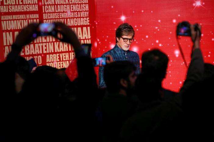 People take pictures of a waxwork of Bollywood actor Amitabh Bachchan at a photocall for the new Madam Tussaud's waxwork museum in New Delhi, India January 12, 2017. REUTERS/Cathal McNaughton