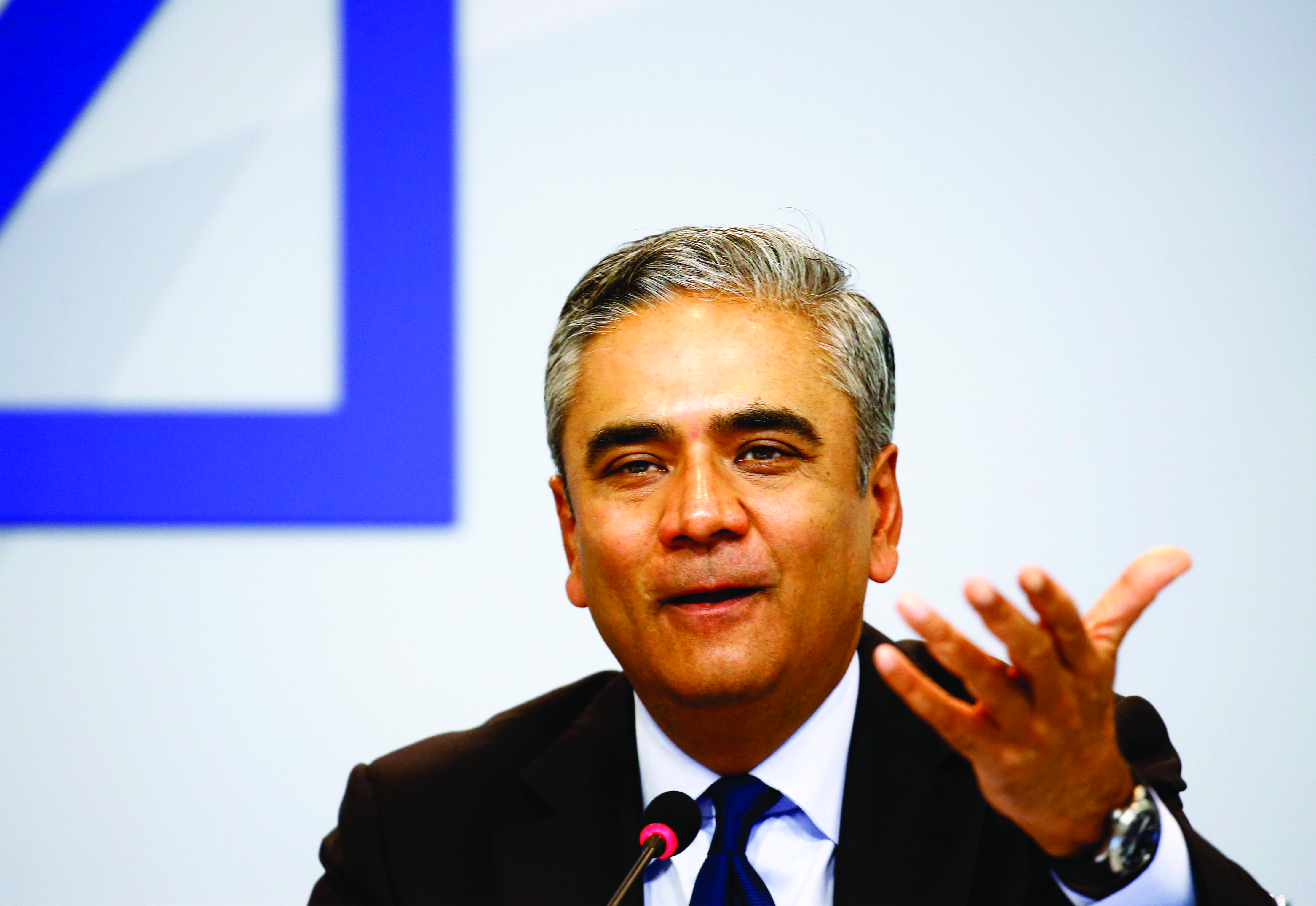 Anshu Jain, co-CEO of Deutsche Bank, gestures at a news conference in Frankfurt, Germany, April 27, 2015. Deutsche Bank will cut 200 billion euros ($217.5 billion) in investment bank assets and exit a tenth of the countries in which it operates as part of a restructuring program designed to boost earnings and cut risk. REUTERS/Kai Pfaffenbach - RTX1AFMH