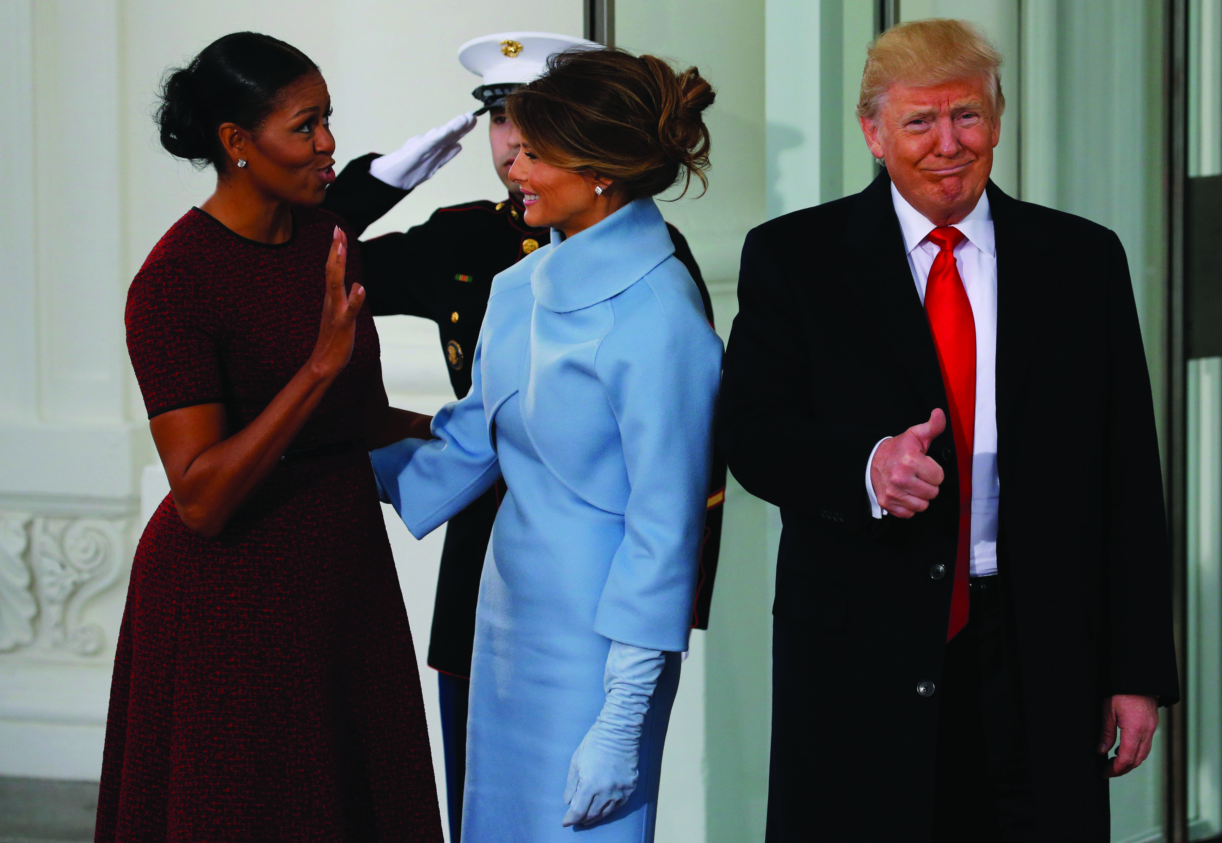 U.S. first lady Michelle Obama (L) greets U.S. President-elect Donald Trump (R) and his wife Melania for tea before the inauguration at the White House in Washington, U.S. January 20, 2017. REUTERS/Jonathan Ernst