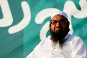 "Hafiz Muhammad Saeed, chief of the banned Islamic charity Jamat-ud-Dawa, looks over the crowed as they end a ""Kashmir Caravan"" from Lahore with a protest in Islamabad, Pakistan July 20, 2016. REUTERS/Caren Firouz/Files"