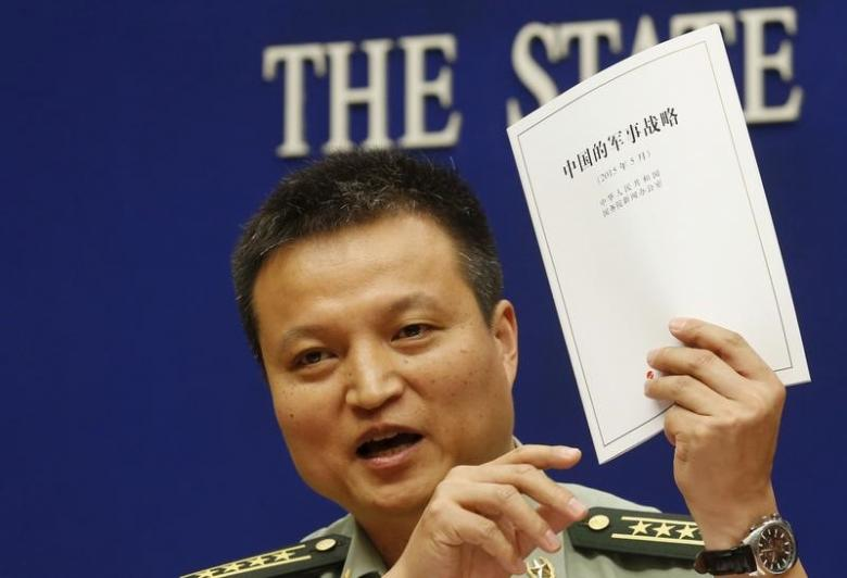Spokesperson of Chinese Ministry of National Defense Senior Colonel Yang Yujun holds a copy of the annual white paper on China's military strategy during a news conference in Beijing, China, May 26, 2015. REUTERS/Kim Kyung-Hoon
