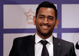 India's cricket captain Dhoni smiles during a news conference in Mumbai