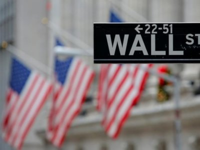 A street sign for Wall Street is seen outside the New York Stock Exchange (NYSE) in Manhattan, New York City, U.S. December 28, 2016. REUTERS/Andrew Kelly/Files