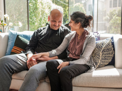 Rahul Desikan, a scientist studying ALS at the University of California at San Francisco, and his wife, Maya, are pictured at their home. Must credit: Photo by Nick Otto for The Washington Post