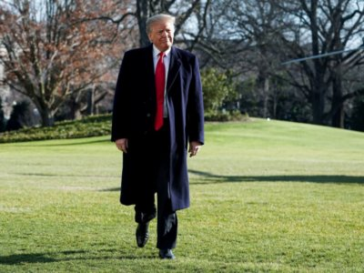 U.S. President Donald Trump walks before speaking to the media as he returns from Camp David to the White House in Washington, U.S., January 6, 2019. REUTERS/Joshua Roberts
