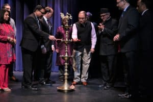 The guests of honor light the traditional lamp at the IHCJ/Natya Darpan event March 16, 2019 in Edison, N.J. (Photo courtesy IHCJ/Natya Darpan)