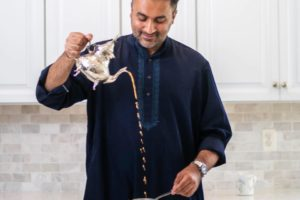 Ahmed Hassan, Indian-American candidate for Virginia House of Delegates, posing pouring tea. (Photo: Facebook profile photo - Hassan For Virginia)